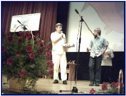 Pascal offering his prize during awards party in Kiev