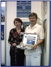 Mrs L.Kotelva and Pascal in front of awarded painting
