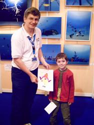 Pascal Lecocq with young contestant at the Paris Dive show 2007, with publishing parents authorization
