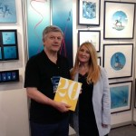 The President of the Paris Dive Show, Helene de Tayrac-Senik presents the 20 years of the Paris Dive Show in Pictures to Pascal.